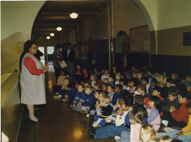 Carole Speaking in front of a crowd